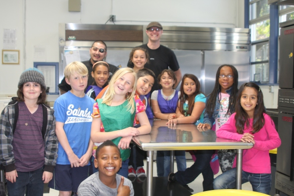 Nathan Odom, pictured on the far left, is a former McKinley student and participant in the Scratch after-school cooking class.
